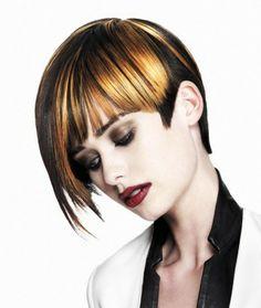 A short brown straight coloured Multi-Tonal choppy Womens haircut hairstyle by Rae Palmer