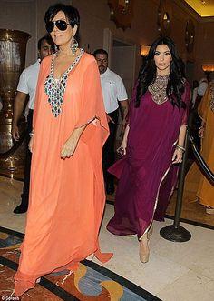 Kardashian's camel ride in dubai wearing purple abaya