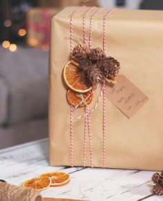 Make your gifts extra special with this dried fruit & pinecone treatment!