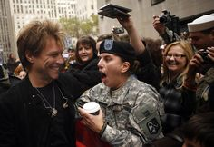 msn.com - Singer Jon Bon Jovi embraces U.S. Army Spc. Cindy Paulo after performing on NBC's TODAY show in New York's Rockefeller Center