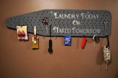 """Great laundry room idea. Chalk paint on an old metal ironing board! Add """"S"""" hooks to the holes & hang items (missing socks?)."""