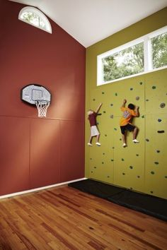 This colorful climbing wall adds a whole new dimension to this large home gym.