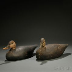 $1600 Two Black Duck Decoys, Anthony Elmer Crowell (1862-1952), East Harwich, Massachusetts, each of carved and painted wood with turned head, inset glass eyes, original paint, oval brand mark, (imperfections), ht. 6 1/2, 7 1/4, wd. 6, 6 1/4, lg. 16 3/4, 16 1/2 in.  Provenance: These decoys were reportedly used by W.H. Wood (the consignor's grandfather) and his sons at Great Pond, Wellfleet, Massachusetts, in the 1920s and 1930s.