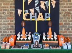 Just the backdrop, for a dessert table.  LOTS of red and white pennants.  Also a bean bag game/ football goal.