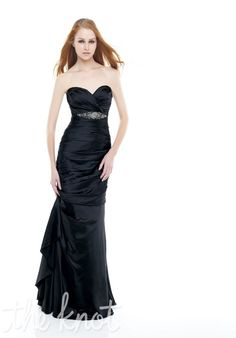 Dress features applique and corset back. Bill Levkoff.