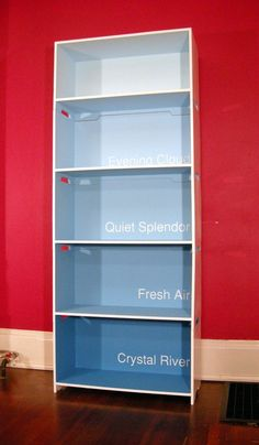 Cool idea. Ombre/paint chip bookcase.