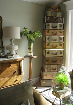 Adore the stacked, vintage suitcases; never tire of these imaginative displays