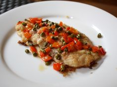 When dipped in flour, the skate wing crisps up beautifully and the capers take care of the rest. Sure, red pepper and shallots may add some color, but it's the briny capers that really carry the sauce and help balance the creamy flesh of the skate.