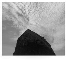 Black and White Haystack Rock. #canonbeach #canonbeachoregon #pnw #pnwonderland #pnwdiscovered #pnwcoast #haystackrock #clouds #cloudsky #oregoncoast #oregonexplored #oregonnw #blackandwhite #upperleftusa