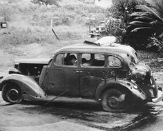 December 7, 1941: Eight miles from Pearl Harbor, shrapnel from a Japanese bomb riddled this car and killed three civilians in the attack. Two of the victims can be seen in the front seat. The Navy reported there was no nearby military objective. (AP Photo/U.S. Navy) #