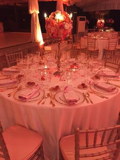 golden candelabra table set up with sphere of roses on top