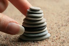 Zen balance stackable beach stones found on the shore of the Baltic Sea.  Flat pebbles were meticulously selected from all the countless stones on the beach to create this special set of stones for you to touch, feel and arrange them in a way that will lead you to the serenity of mind.  10 pieces  Pebbles are 1.3-3.7 cm (1/2-1 1/2) big.  Gift wrapping included.