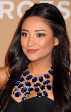 Shay Mitchell- Emily from pretty little liars! Love her necklace & hair!! :)