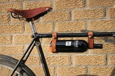 Get to carry your favorite bottle of vintage in a classic leather style as you ride through on the bike with this Bicycle Wine Rack.