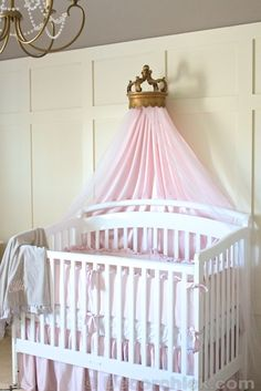 Nursery bedding and bed crown love it