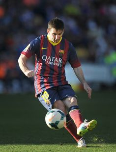 Lionel Messi of FC Barcelona takes a free kick with during the La Liga match between Real Valladolid CF and FC Barcelona at estadio Nuevo Jose Zorillo on March 8, 2014 in Valladolid, Spain.