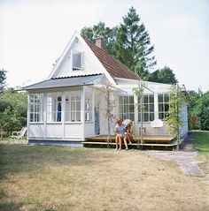 little white house, no link or floor plan but I like the window-filled entry and the deck outside the door.