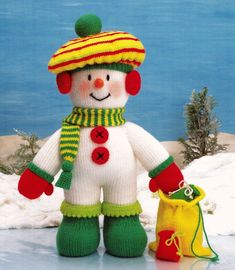 """Meet Albert from Jean Greenhowe's 'Snowtime Friends' collection. Perfect as a Christmas gift he is also great just as a cuddly toy for no special reason whatsoever. Knitted in DK wool he is easy to make and is about 41cm/16"""" high (excl. head decor). Designed and published by Jean Greenhowe Designs in 1994."""