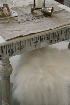 love this idea - tape measure on the edge of the cutting table.  No need to inlay one onto the surface!  Reclaimed/second hand table - re-painted.  Brilliant for the craft room.