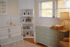 such an adorable, not over-the-top nursery. love the built-in corner bookshelf.