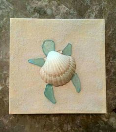 Shell and sea glass turtle art. I think I'll make one or more of these.