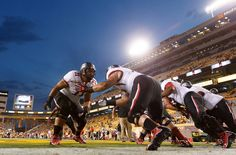(Trent Nelson     The Salt Lake Tribune)  Doing their part to keep up the trend of college football teams wearing bold, unusual, imaginative uniform combinations, the Utes uncloaked white-on-black helmets worn with white jerseys and black pants during the game against Arizona State on Sept. 22, 2012.