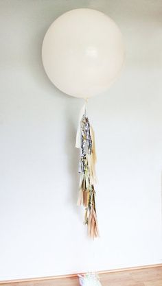 Party Guide: Decorate Your Digs For an Oscars Bash: A sprinkling of this gold star confetti ($2) against a white tablecloth can mimic the effect of a shimmering table runner (for a fraction of the price!). : Anchor your bar or buffet with a festive visual, like this oversize tassel balloon ($27).