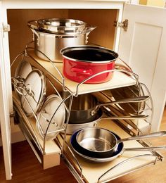 Base Cookware Storage Roll-out - KraftMaid... Beautiful with the lid holders on the sides - tucked away like that! :)