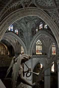 Interior of the Catedral de Sevilla (Seville Cathedral), Spain. View off the crossing dome.The interior has the longest nave of any cathedral in Spain. The central nave rises to a height of 42 meters and is lavishly decorated with a large quantity of gilding.