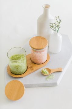 Matcha Mint & Lavender Citrus Bath Salt Set made by esselle SF. The set includes a gilded wooden spoon designed by esselle, two glass jars, a bamboo tray and 12 oz. of bath salts. Bath and Body