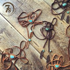 Concho Choker Wrap Necklace- Wrap style choker necklace. Scalloped leather setting. Natural turquoise stone. Long leather wrap ties. Hand tooled leather feathers and turquoise accents.