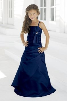 Alexia Designs style 28: Matches bridesmaids style 2946. Matte satin strapless bridesmaids gown with vertical pleating on the bust. Asymmetrical pleating surrounds the body of this gown with a banded bow and broach under the bust.