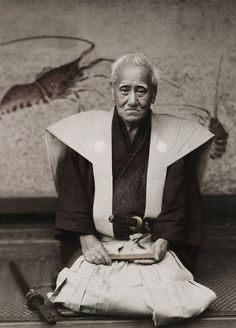 Photo of an old samurai, circa 1890, Japan, by photographer Kozaburo Tamamura. The abolishing of the samurai class by the Emperor had occurred in the late 1860's, so by the time this photograph was taken in about 1890, the former samurai still alive were getting elderly, as reflected in this portrait.