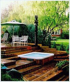 hot tub deck Get help with your backyard planning with Hot Spring Spas landscaping ideas, hot tub deck design tools, and patio planner for outdoor hot tubs. Learn more about our backyar Small Backyard Decks, Backyard Plan, Backyard Patio, Sloping Backyard, Small Patio, Deck Ideas Townhouse, Whirlpool Deck, Tiered Deck, Hot Tub Deck
