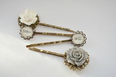 A sweet bookish hair grip set featuring two book page cabochon grips and two floral filigree grips inspired by the best selling book series by