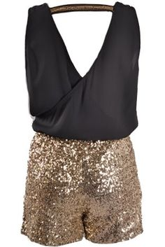 Backstage Pass Playsuit: Features a chic overlapping upper portion with embroidered gold trim highlighting the edges, horizontal band at the nape to pull it all together, and glittering gold sequin romper shorts to finish.