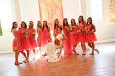 Guava bridesmaid dresses with great bouquets