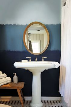 If you can't get enough of Blueprint and its soothing color family, try layering it with lighter and darker shades for a pretty ombre look. #coastalbathrooms #behr's2019color #ombrepaint