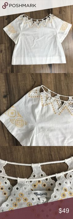 Madewell Eyelet Peekabo Top NEW Brand new with tags Madewell eyelet peekaboo top Women's Size Large Sold Out Online   PRODUCT DETAILS Pretty and delicate, this embroidered top has a scalloped detail at the neckline for a peekaboo effect. Inspired by a lucky vintage find, this eyelet style looks particularly great over a bralette. True to size. Cotton. Machine wash. Import. Madewell Tops