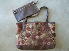 Modern tapestry designed with faux leather #faux leather #purse #clutch #tote #jackie robbins