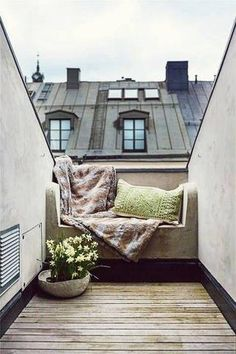 I love the use of space on this balcony. It is cozy and functional. It would actually be usable.
