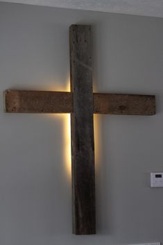 Wooden Cross with light for wall out of old barn wood...