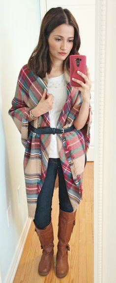 DIY your own cape! Throw a blanket scarf around your shoulders and belt it around the waist for shape.