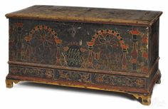 """Berks County, Pennsylvania painted poplar dower chest, dated 1785, inscribed Eefa Dunckels, the front with two tombstone panels and potted tulips flanked by pillars and heart corners, above three drawers supported by ogee bracket feet, 26"""" h., 48"""" w.  Provenance: Descended in the family to the present owner. Estimate: $8,000-12,000"""