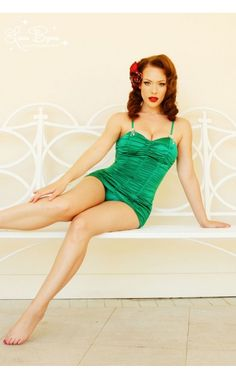 For years, our customers have asked us to design a one piece vintage-inspired suit. We're perfectionists, so we took some time getting the look just right. The result is the Marilyn Swimsuit - a gorgeous, gathered, skirted thing of beauty that evokes old Hollywood glamour - and is designed to hold you in, and push you up, for an extremely sexy beach silhouette.