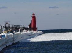 Lake Michigan Winter pictures 2014 Grand Haven   South Pier and Lighthouse in Winter at Grand Haven on Lake Michigan