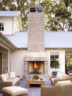 Like how the patio is open/no roof, fireplace is stucco with metal roof. Like the style
