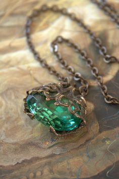 Czech Green Glass necklace... a good example of filigree bent around a stone to encase it.