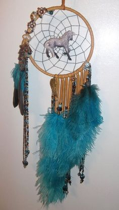 6 inch custom Dream Catcher - sold - handmade with tan deerskin, bronze and silver beads, glass and ceramic beads, lots of blue teal ostrich feathers and wire wrapped with bronze, silver flowers, leaves and beads. One of a kind - for more designs https://www.facebook.com/pages/Dreamscape/471890606282556