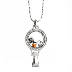 Origami Owl Trick or Teach Locket Set + Fa-Boo-Lous Halloween Favorites +  Sport un-BOO-lievable style to the workplace with our fun and festive Halloween-themed Lanyard Living Locket®. Featuring two of our Limited Edition Halloween Charms, these little ghouls in your life will be sure to offer more treats than tricks. Include a little extra sparkle by sprinkling in our Limited Edition Purple Velvet Stardust Crystals by Swarovski®.  https://staciemarshman.origamiowl.com/